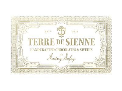 Terre de Sienne ornate chocolate monogram logo packaging branding typography
