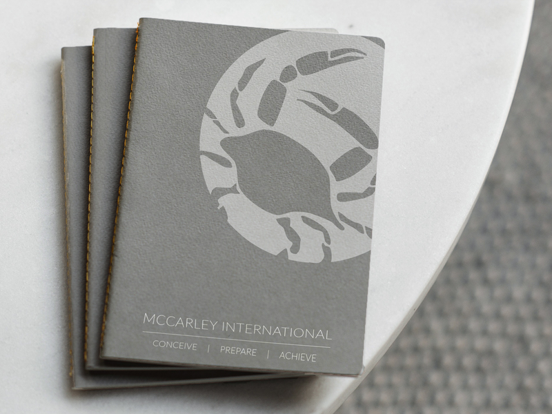 McCarley International Notebook printdesign notebook modern simple logo design branding
