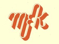 M K Logo
