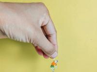 Miniature human- life holding you