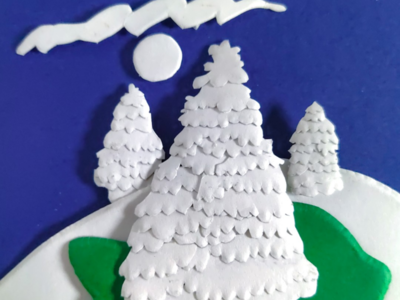 Diy papersculpture of christmas tree covered in snow