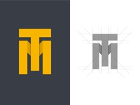 "Logo done letters ""T & M"" with a 3D effect."