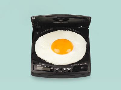 Egg cd wierd vintage white yellow green photoshoot artdirection art discman egg