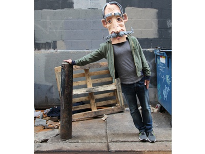 Big Head in Philly alley green wall face moustache mask art pennsylvania philadelphia philly sculpture head paper-mache