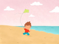 boy with a kite in his hands