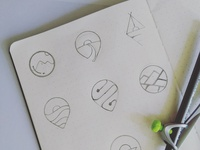 Sketches for a logo related to travel, journey and exploration