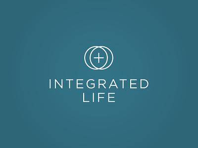 Logo for the Integrated Life union mindfulness psychology catholic cross plus sign eucharist life integrated
