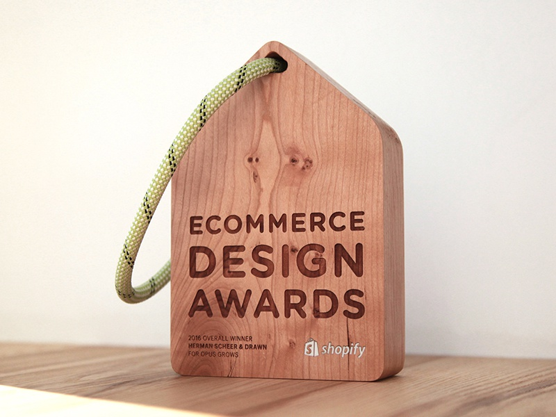 Ecommerce Design Awards trophy commerce awards shopify rope resin laser-cut wood object trophy