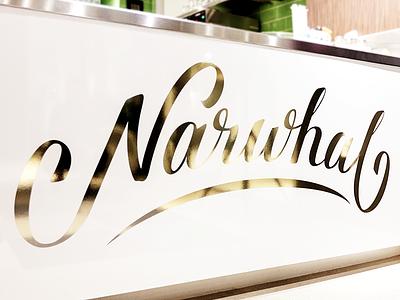 Cafe Narwhal gold foil signage lettering
