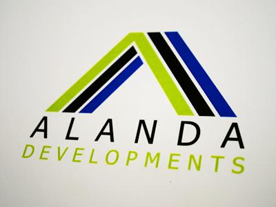 Alanda Developments logo branding green black blue corporate