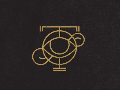 T & F logo monogram eye gold black icon type rawk