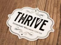 Thrive Veterinary Wellness Center logo