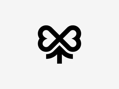 Flower + Ribbon mark icon logo present bow ribbon plant petal flower