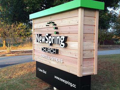 NewSpring Cedar Sign newspring church environment signage cedar wood brand akzidenz