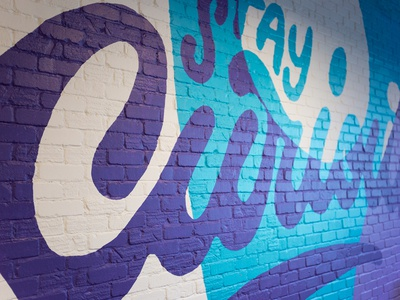 Curious Mural office art script illustration vector typography smiledirectclub type lettering brick wall mural curious