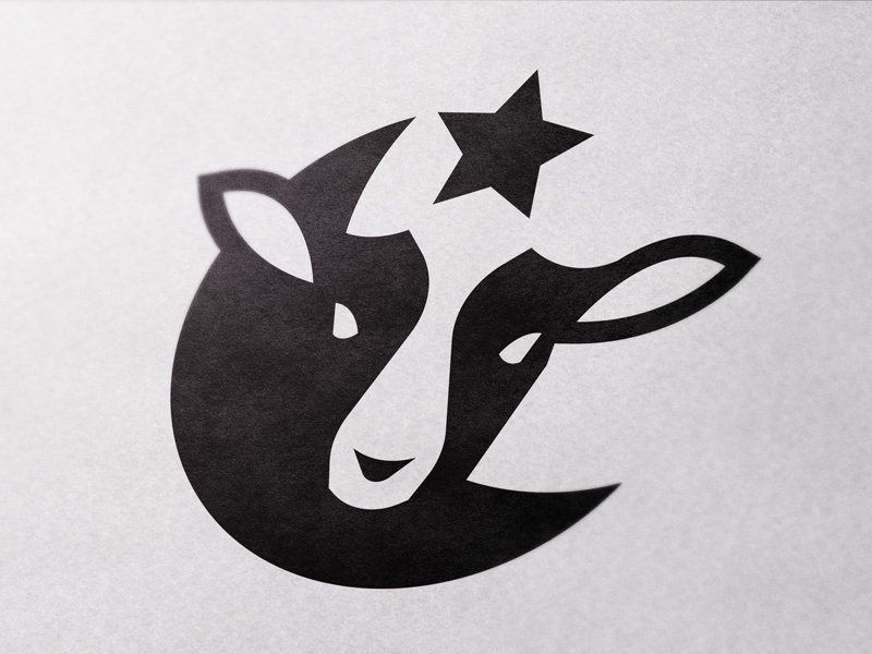Logo for family owned farm identity branding simple bold minimal cow black white space negative star moon islam halal organic logo farm animal meat lamb
