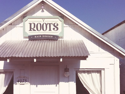 Roots Physical woodwork photo sign