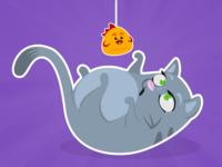 Kitten playing with its plush birdie