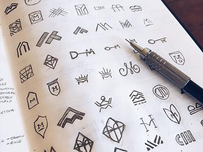 Drew Morris Realtor Logo Concepts branding luxury mountain shield crest monogram m key house real estate logo design logo