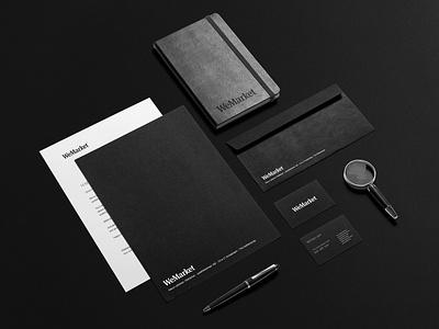 WeMarket Branding minimal business card envelope card paper pen and paper notebook stylish modern luxe luxurious clean magnifier pen dark black box print branding moleskin