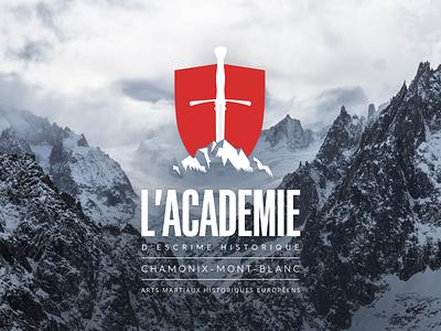 AEH Logo w/Mountain Background club negative space shield longsword historical hema fencing sword mountain logo
