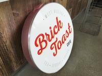 Brick Toast Cafe Store Sign