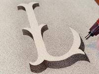 Letter L, trying white on black