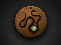 Wooden Snake Talisman with Peridot