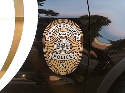 Eagan Police Car silver gold badge crest eagan police branding logo city