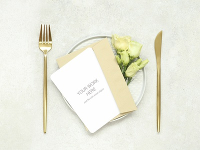 Mockup Invitation card on plate and gold cutlery