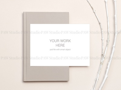 Card mockup on notebook and branches