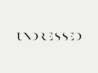 Undressed reduced typography logo black white minimal naked undressed
