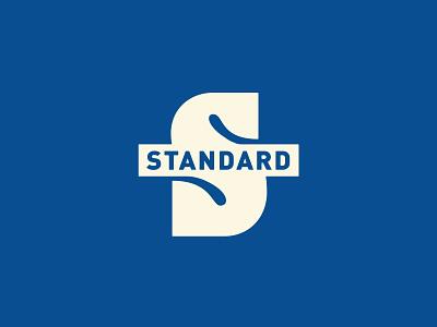 Standard Apparel logo outdoors badge custom lettering type
