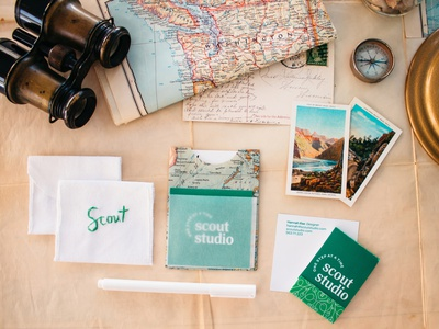 Scout Studio velum typoography studio scout business card flatlay photography embroidery logo logotype branding system green paper travel maps stationary design