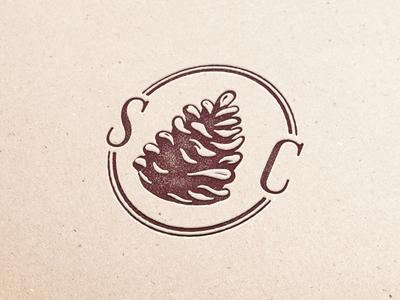 Spring Creek Stamp line serif identity brand forest logo illustration forest floral wedding initials one color icon pinecone monogram ink paper texture block print stamp linoleum