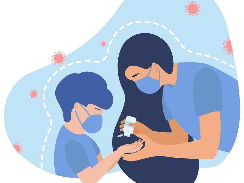 Mom gives the baby a hand sanitizer. girl flu female family face epidemic environmental environment dust danger covid-19 coronavirus corona child care boy biological bacterium allergy air