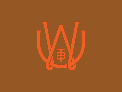 Uncle Wolfie's Breakfast Tavern logo lettering softball monogram