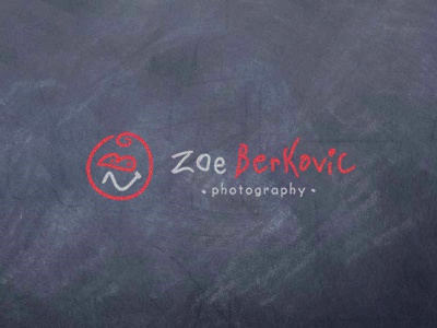 Zoe Berkovic - photographer logo photo child smile face chalkboard red photography