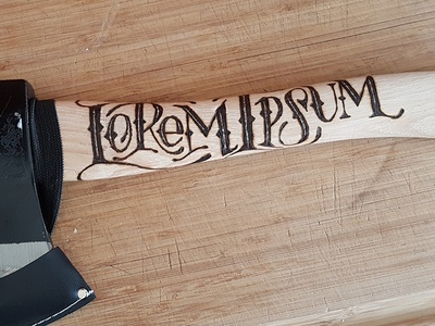 Lorem Axe axe throwing wood burning hand lettering