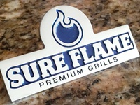 Sure Flame Metallic Grill Logo