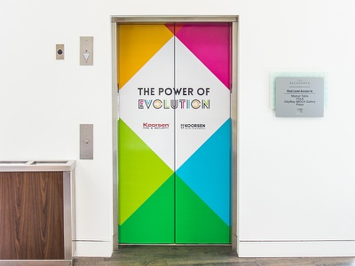 2017 Sales Conference Elevator Wrap environmental graphics blue green magenta yellow colors elevator wrap graphic design design wrap