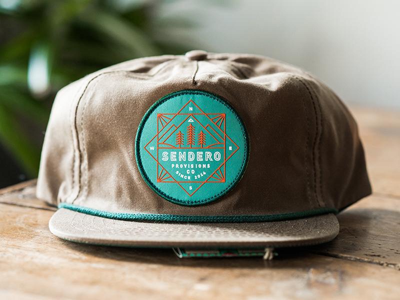 Sendero tree river lockup badge nature outdoors apparel illustration typography branding logo hat