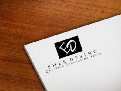 emek Paper Logo Mock up On Wooden Table