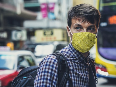 Man in Face Mask in City [Free PSD Mockup] mock-up free psd free mockup free download freebie psd photoshop mockup medical mask free file face download audio equipment