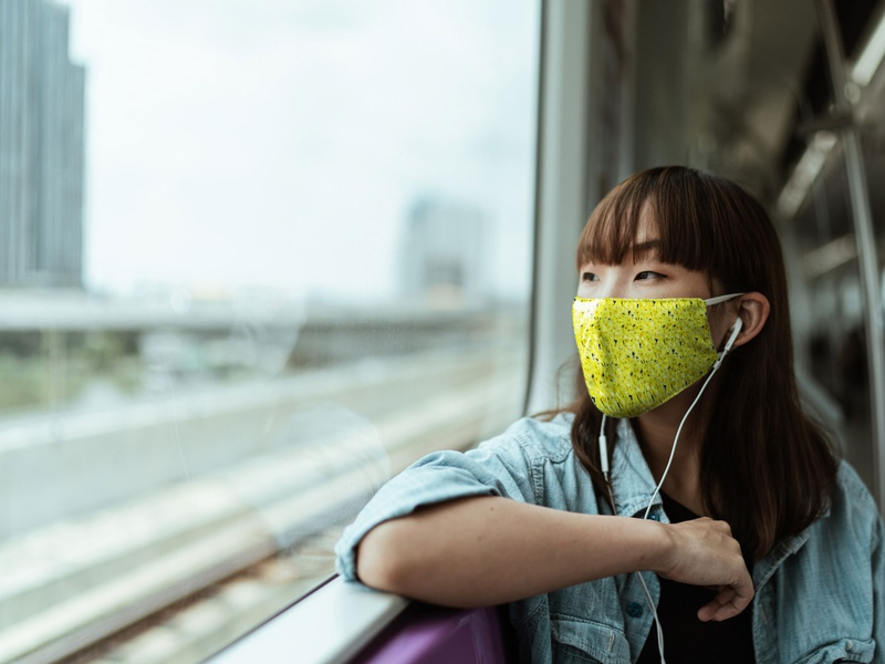 Mask Mockup With Young Woman in Train [Free PSD Mockup] mockup free psd free mockup free download freebie woman psd mockup medical mask mask facemask face mask dust protection cloth mask apparel anti pollution