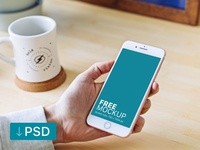 Free mockup: White iPhone In Man's Hand