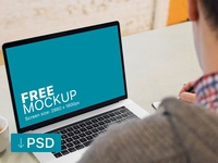 Free mockup: Young Man Working on his Macbook