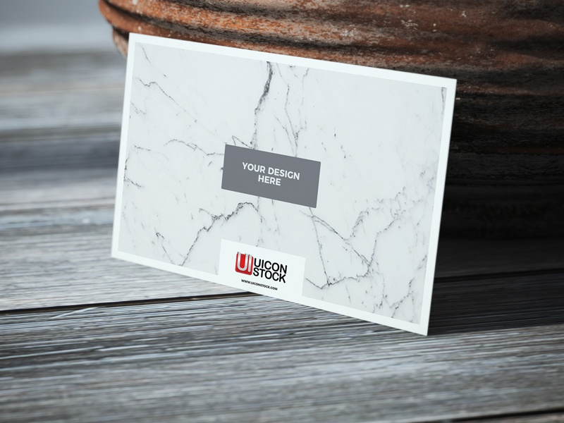 Free usiness card on wooden table mockup