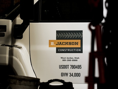 B. Jackson Construction Vehicle Graphics visual identity vehicle graphics branding