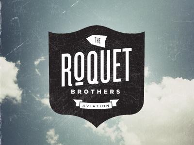 Roquet Bros logo brand nil santana shields typography